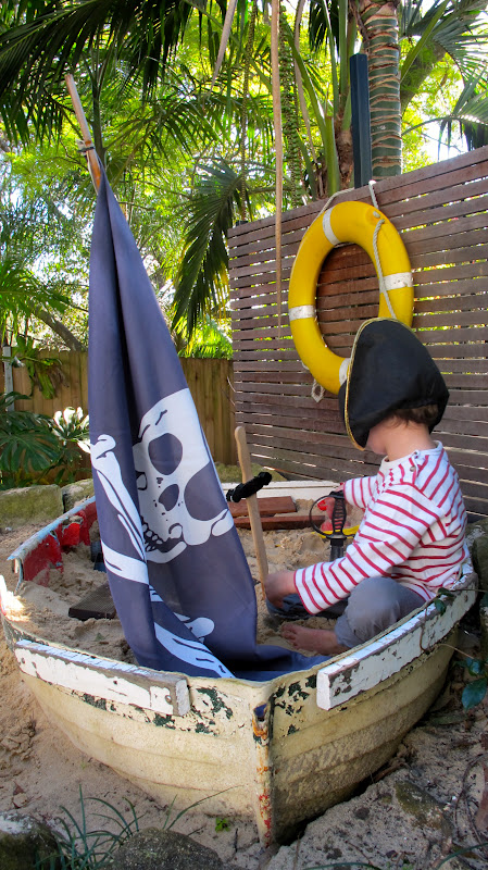 5 Old Boat Sand Pit with Pirate Flag