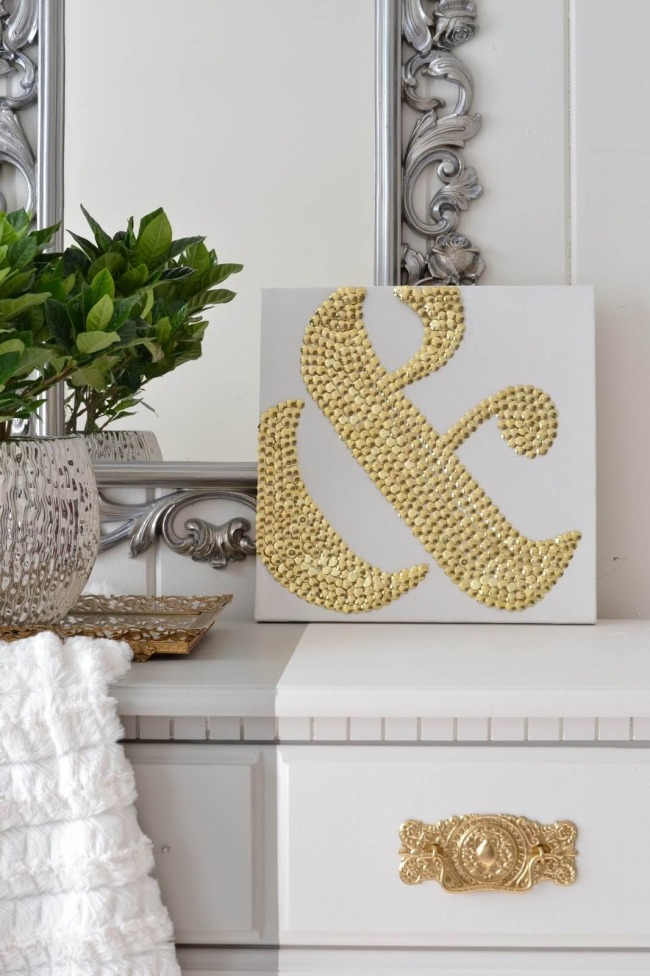 21 Awesome DIY Ampersand Art Using Golden Thumbtacks over White Canvas as a Beautiful Hall Art