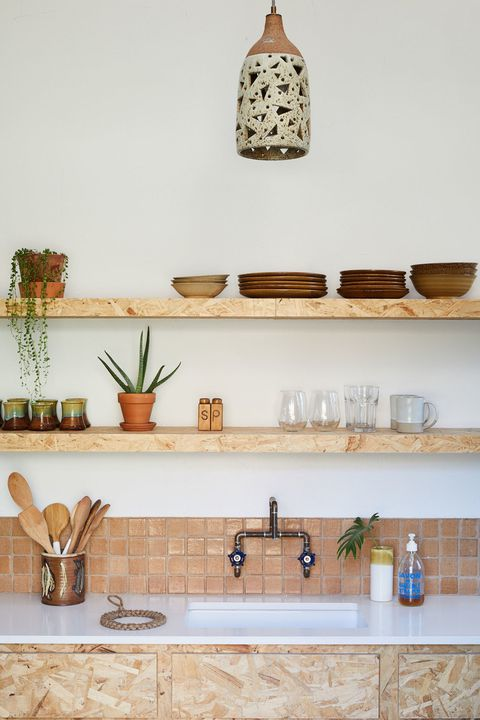 4 Beautifully Pair Down Kitchen Stuff on OvertheSink Wooden Shelves along with some Plain Plant Dcor