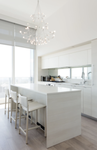 12 Classy Kitchen Arrangement with Statement Lighting OvertheDining Space in Sophisticated White ...