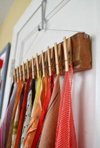 31 Creative DIY Storage Solution with Clothespins over Wooden Board as the Quick Closet Organizer