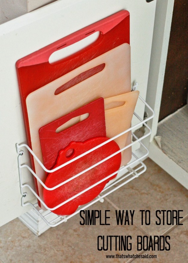 13 DIY Useful Cutting Board Storage on Cabinet Wall with Enough Space and made of Cheap Iron Pipes