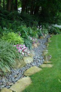 36 Exclusive Rocky Garden Edging Design by Using Small Pebbles Layering inside the Natural Large ...