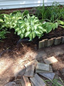 Make Use of Treated Scrap Wood Blocks for Garden Edging