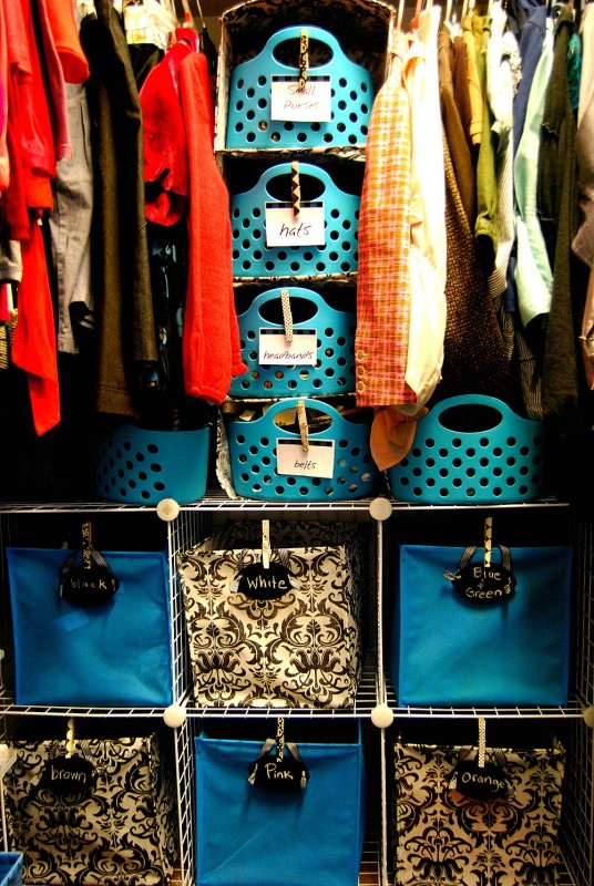 27 Plain Closet Arrangement in Plastic Bins and Wire Baskets with Levels for Different Closet Stuff