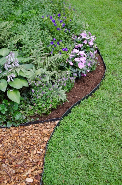 32 Super Cheap and Quirky Garden Edging with Wood Chip Mulching inside Black Plastic Borderline