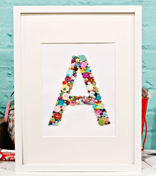 A Tutorial for Crafting Monogram Letter with Buttons on a Plain White Canvas