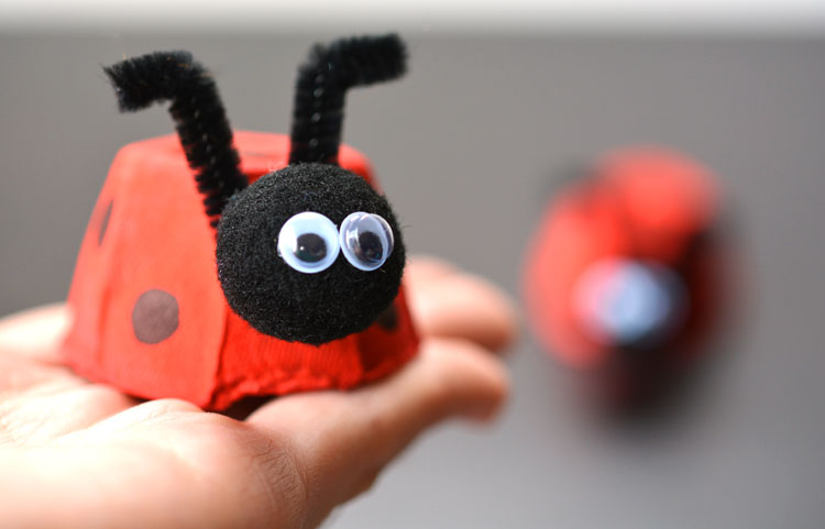 Adorable Easy Egg Carton Ladybugs with Yarn Pom-Pom Head and Pipe Cleaner Strings