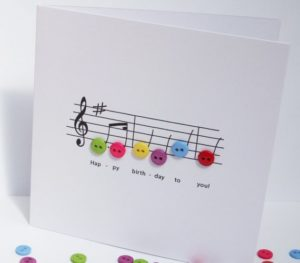 Mesmerizing Birthday Card Craft Idea with Button Decor over a Rhythmic Track