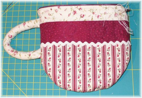 Tea-Cup Pouch Project with Quilting Fabric and Lace Embellishments with a Fluffy Handle
