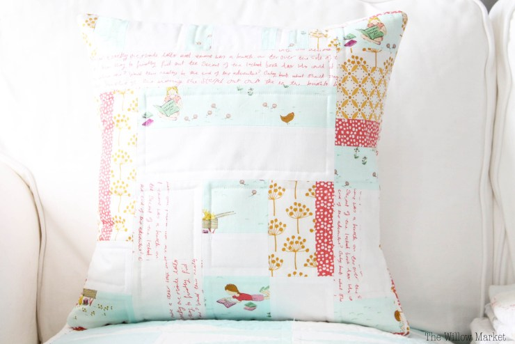 A Scrappy Quilted Pillow Cover with The Diversity of Fabric Scraps in A Free Sew Pattern