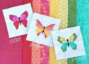 Butterfly Charm Blocks with Vibrant Scrap Fabric Pieces Over Quilt Cover Base