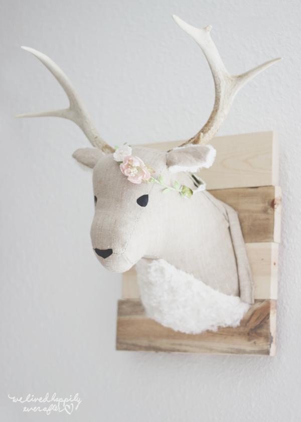 DIY Home Decor Craft: Deer Head Wall Art on Rustic Wooden Pallet Surface