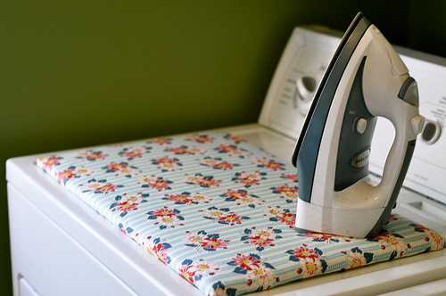 Portable Iron Board Cover from Floral Fabric Scraps Over Wooden Base