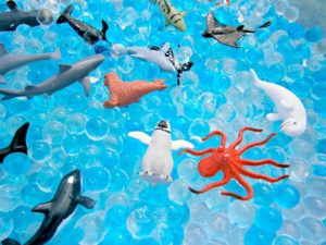 Easy-to-Make DIY Ocean Sensory Bin with Water Balloons and Miniature Ocean Creatures