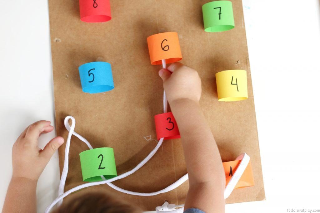 DIY Number Weave Preschool Activity with Colorful Sheets and Shoelace