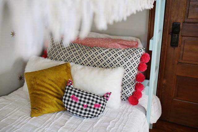 DIY Oversized Floor Pillow Tutorial with Attractive Yarn Pom-Pom Embellishments