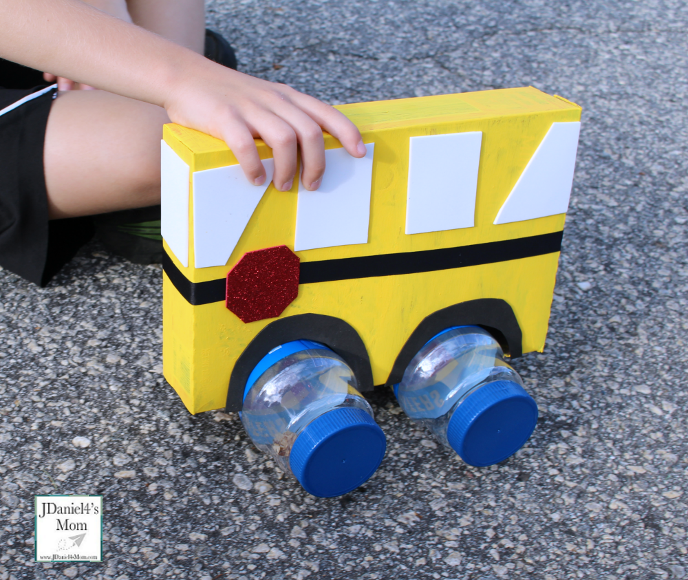 Setting Wheels on the Bus STEM Activity with Empty Bottles Under Felt Vehicle