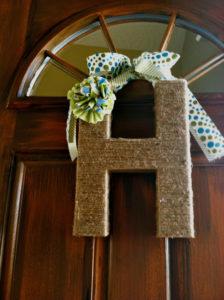 Jute Covered Cardboard with Fabric Embellishment: A DIY Door Decor