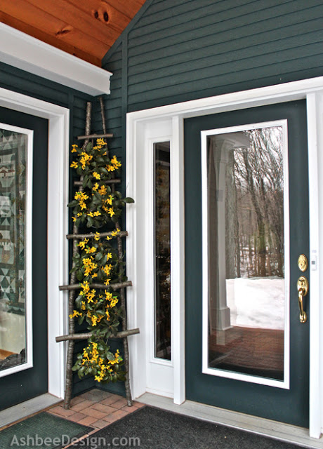 Ladders in Décor: A Floral Front Porch Adornment Idea with DIY Ladder Stuffed with Pretty Flowers