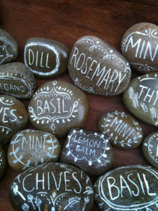 DIY Herb Markers on Pebbles with White Markers for An Organized Gardening