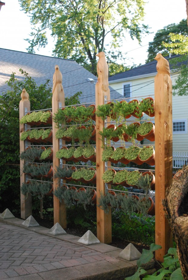 Totally Fascinating Wide And Open Vertical Herb Gardening Idea with Hanging Terracotta Planters