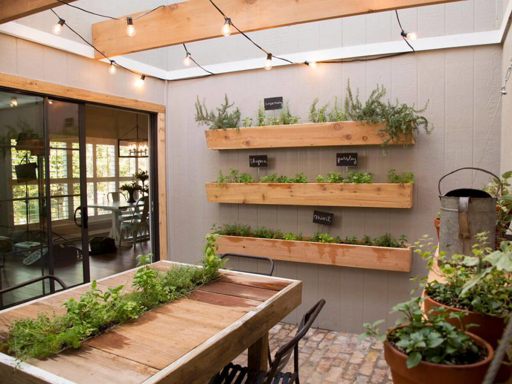Three-Way Sunroom Herb Gardening Idea with Vertical Planters Mad of Fresh Wood Planks