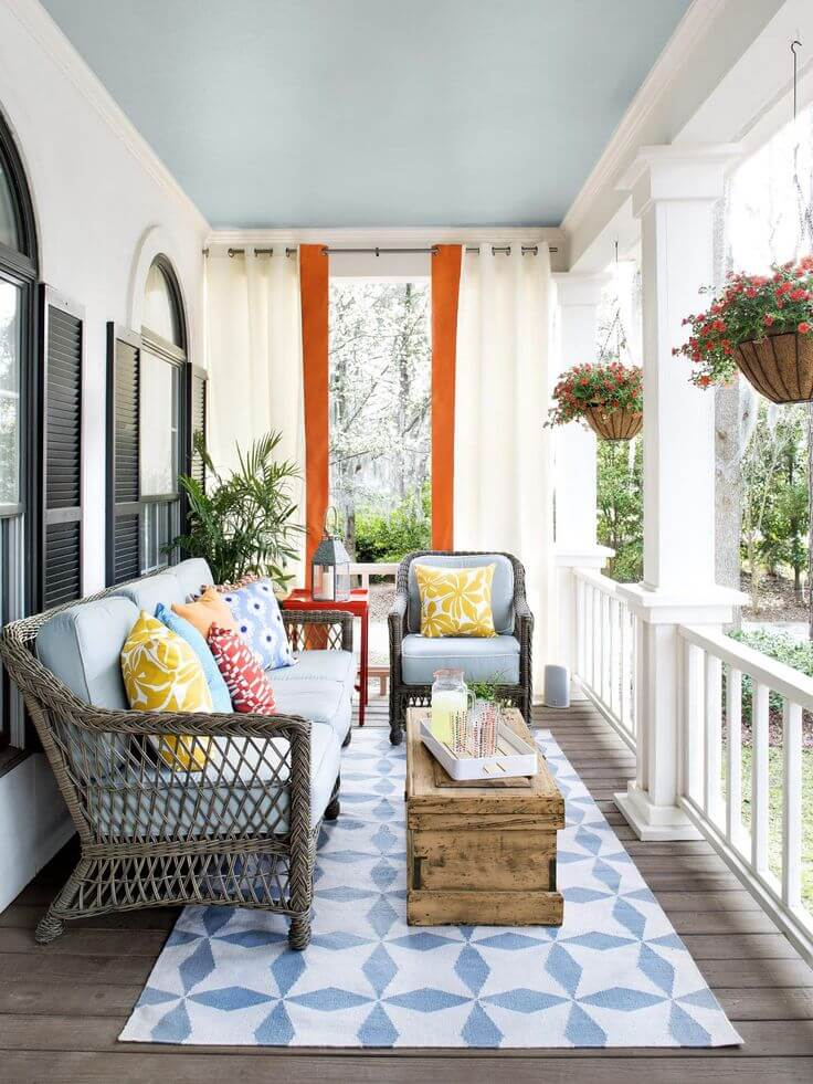 DIY Contemporary Porch Decor Idea with Gray Wicker Furniture Contrasted with Colorful Cushions