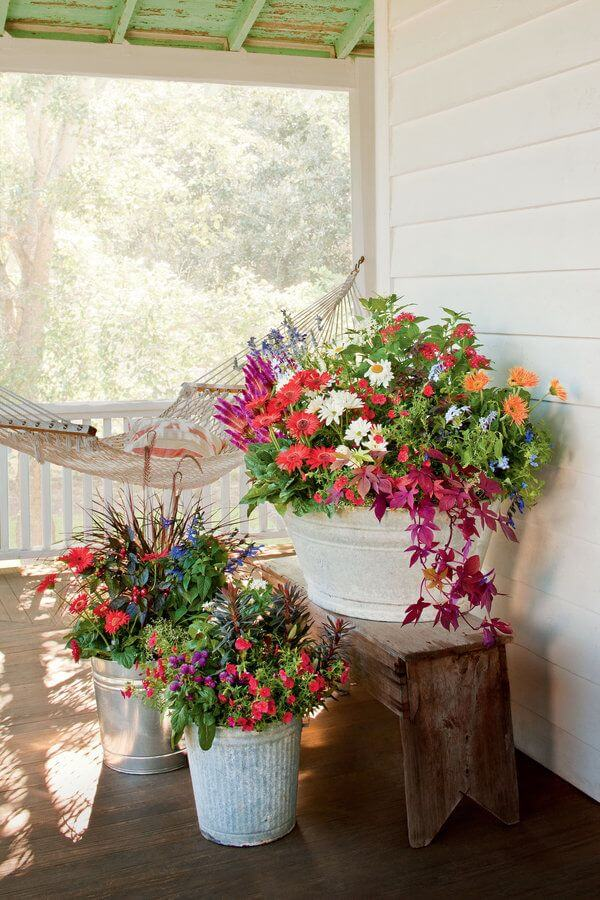 DIY Porch Decor in Vintage Style with Antique-Looking Metal Porch Planter in White Paint