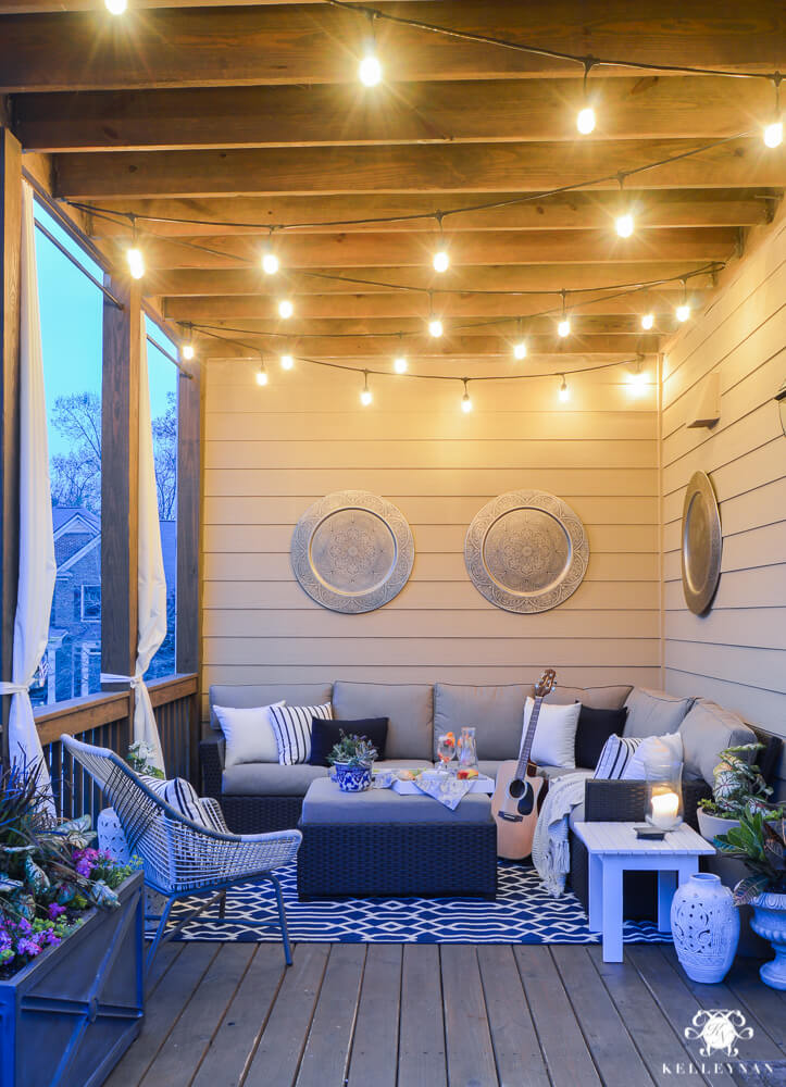 DIY Summer Porch Decor Idea with Sparkling Tunnies and Modern Seating Furniture with a Geometric Rug