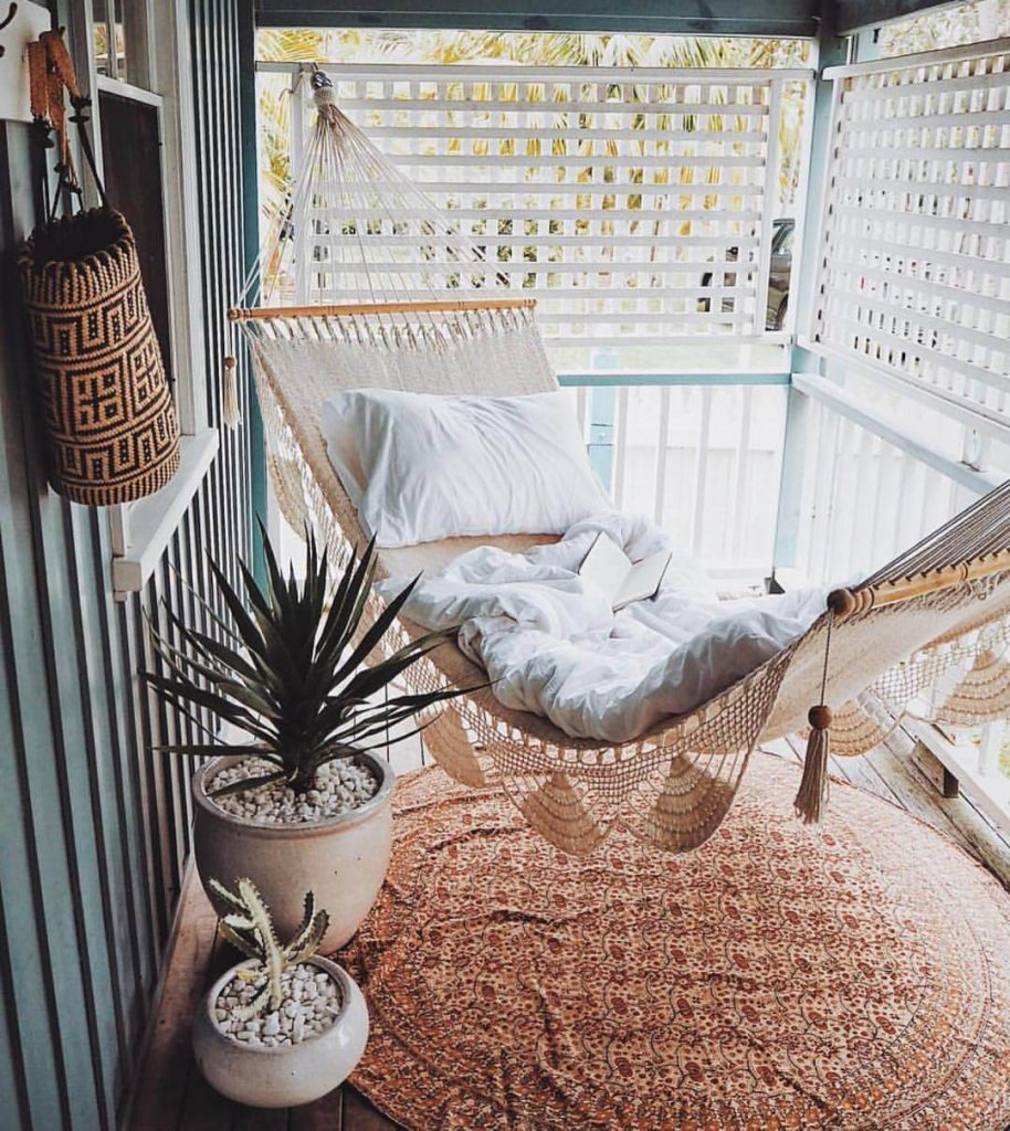 Cozy Porch Decor for Summertime with Bohemian Hammock and Rocky Planters