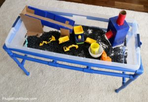 Construction Truck Sensory Bin Project with Toy Truck and DIY Tube Cardboard Ramp