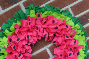 DIY Watermelon Wreath Tutorial for Summer Porch Decor with Cotton Fabric Straps Over WIre Frame