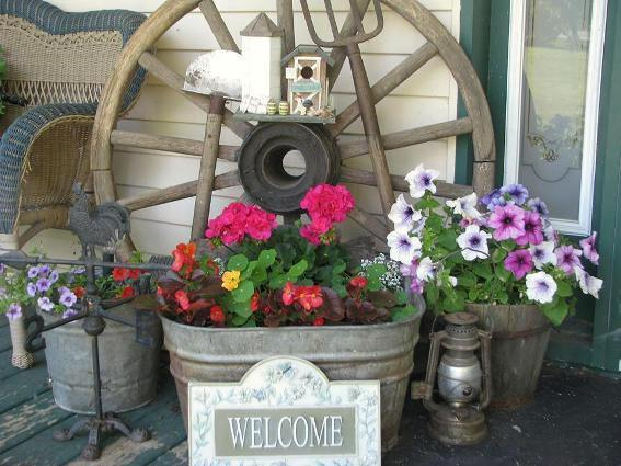 A Magical Garden Background Decor Idea for Front Porch Area with Old Wooden Wheel