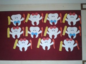 Dental Health Craft Idea for Kids: A Bunch Cute Teeth with Brush and Paste Out of Paper Scraps