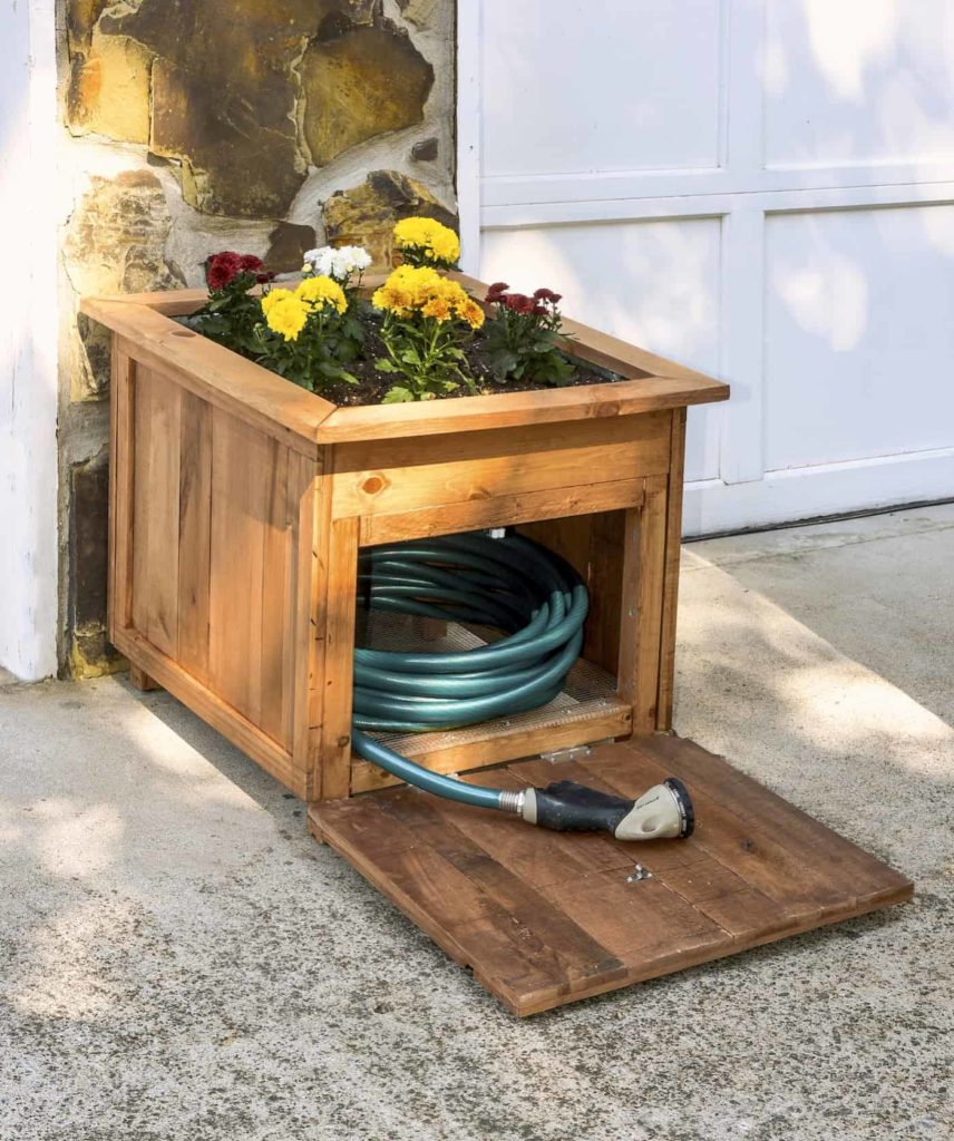 DIY Pallet Wood Hose Holder with Built-In Planter and Hidden Storage Cabin