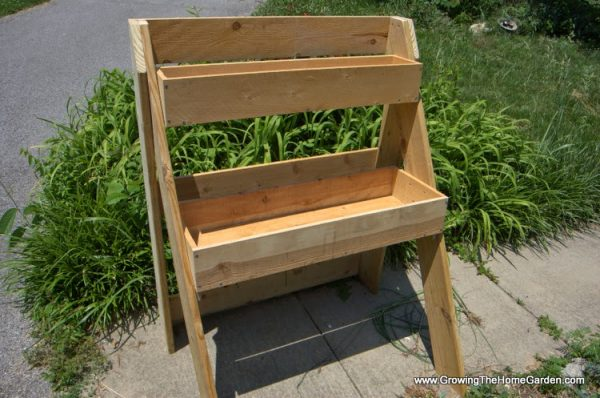 DIY Raised Garden Bed Project for Porch with Layers from Lumber Two-Step Lader