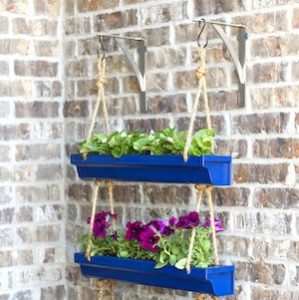 DIY Haning Rain Gutter Planter in Tiered Shape with Charming Bold Blue Accent