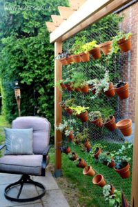 Wonderful Vertical Herb Gardening with Clay Pots on Hexagon Wire Netting Base