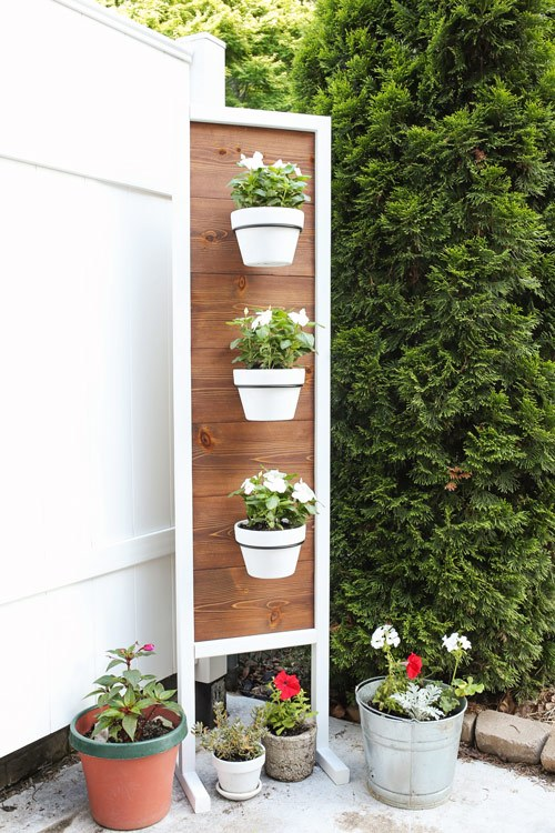 DIY Vertical Gardening: Hanging White Planters on Wooden Stand with Mid Decoration for A Pretty  ...