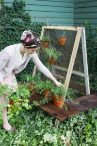 Totally Rustic Farm-Style Vertical Herb Gardening Idea with Upcycle Two-Salvaged Screens on bar  ...