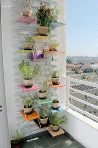 Super Stylish Vertical Herb Gardening Idea with Painted Shelves Set on Wall in Stair-Pattern