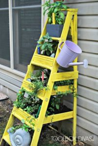 Super Charming Vertical Herb Gardening with Recycled Ladder and Old Watering Can Turn Planters i ...