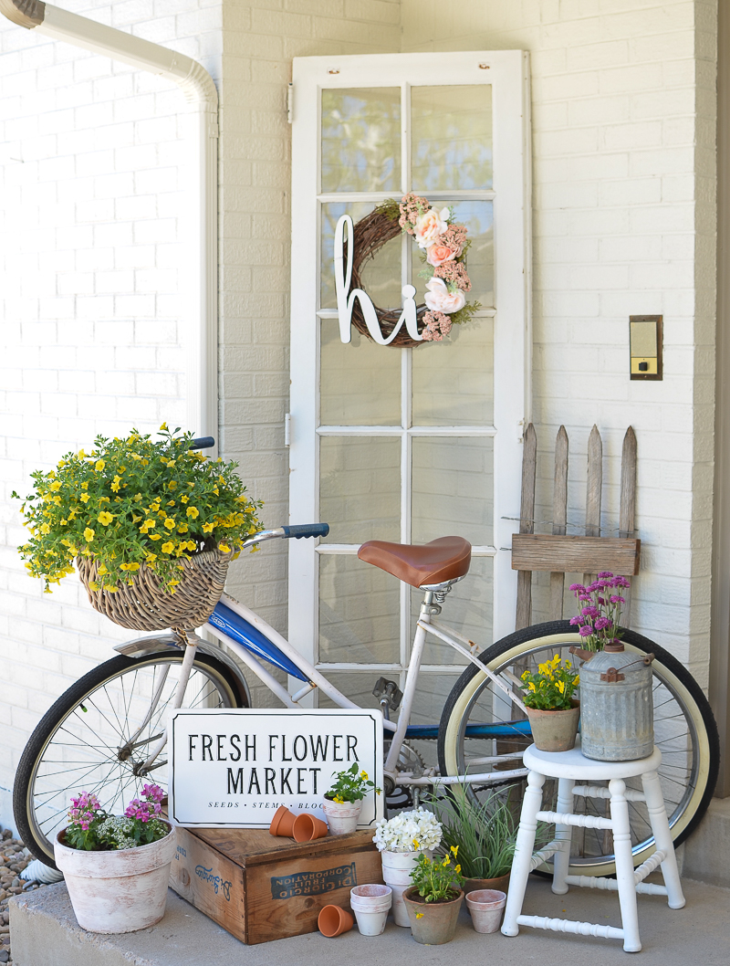 Farmhouse Style Summer Porch Decor with Cycle and A Vintage Flower Market Embellishment
