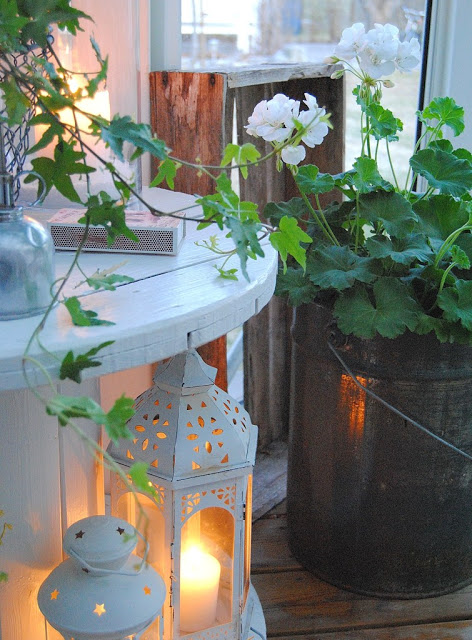Totally Magical Front Porc View Charming Lantern and Metallic Planter with Vintage Touch