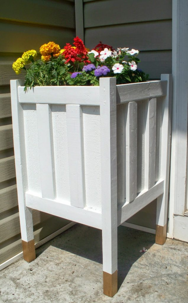 Easy Tutorial of DIY Front Porch Planter With Gold Dipped Legs for A Captivating Porch View