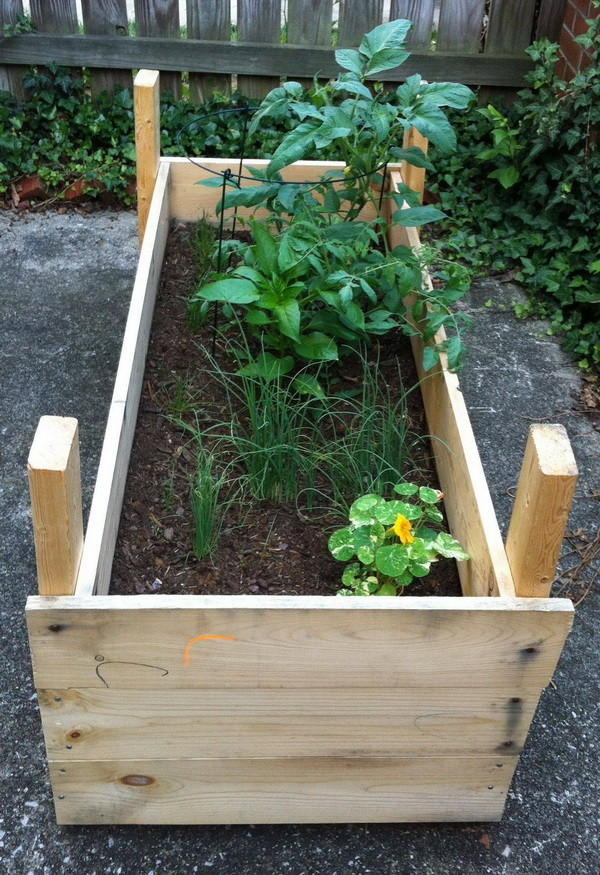 How To Build a Raised Planter Bed for Under $50 with Lumber Boards