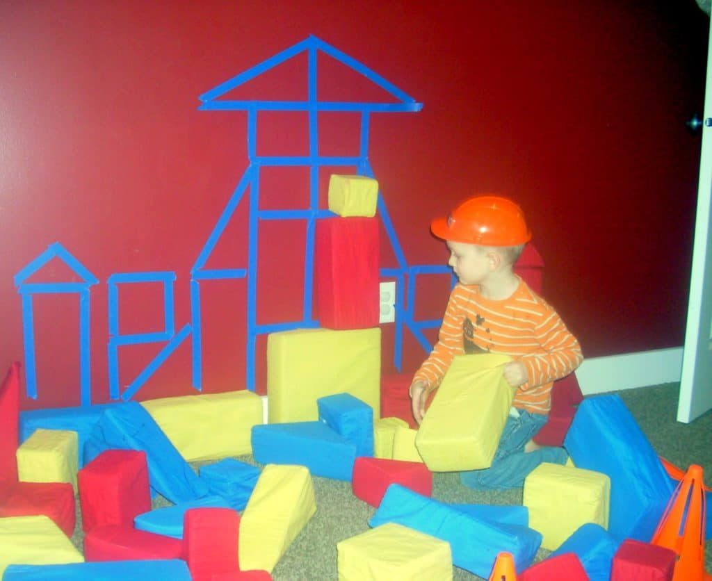 DIY Construction Theme Preschool Activity: House Sculpture with Large Foam Blocks Over Painter T ...