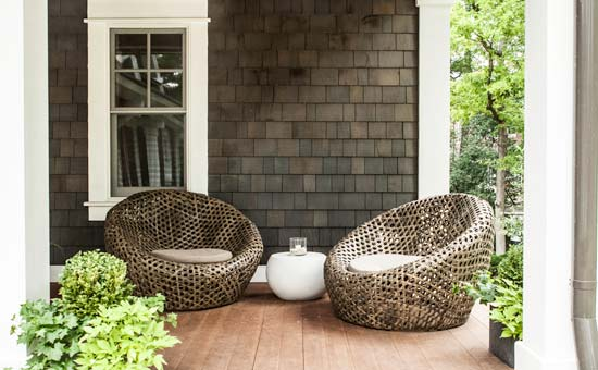 Modern Zen Porch Seating Area with Large Cane-Made Chairs and A Classy Side Table