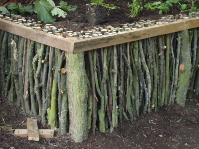 Natural Wood Raised Garden Project from Broken Tree Branches